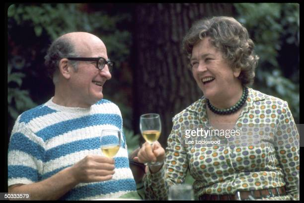 Julia Child and husband Paul Child enjoying a convivial glass of wine in outdoor setting