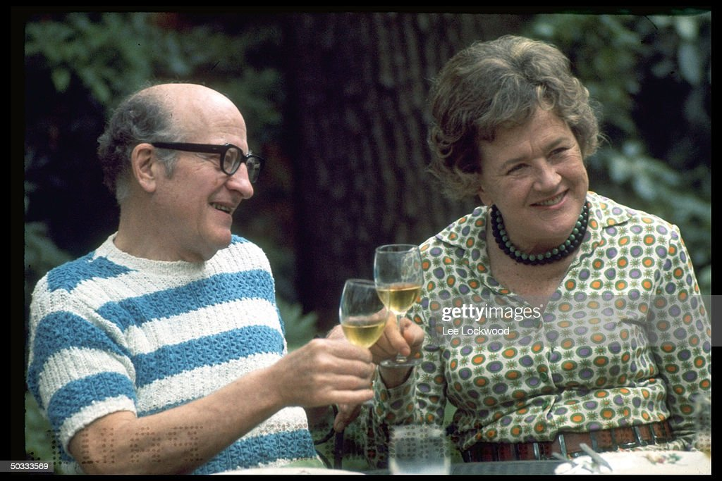 <a gi-track='captionPersonalityLinkClicked' href=/galleries/search?phrase=Julia+Child&family=editorial&specificpeople=206805 ng-click='$event.stopPropagation()'>Julia Child</a> (L) and husband, Paul Child, enjoying a convivial wine toast in outdoor setting.