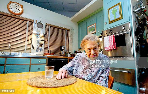 Julia Child sits in her kitchen after being moved and rebuilt from her Cambridge MA home 19 August 2002 as part of an exhibit at the National Museum...