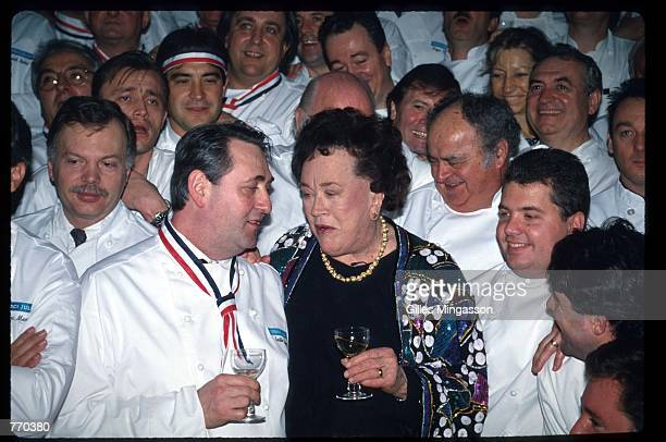 Julia Child speaks with an unidentified guest at a celebration dinner February 7 1993 in Marina Del Rey CA Child who become wellknown through her...