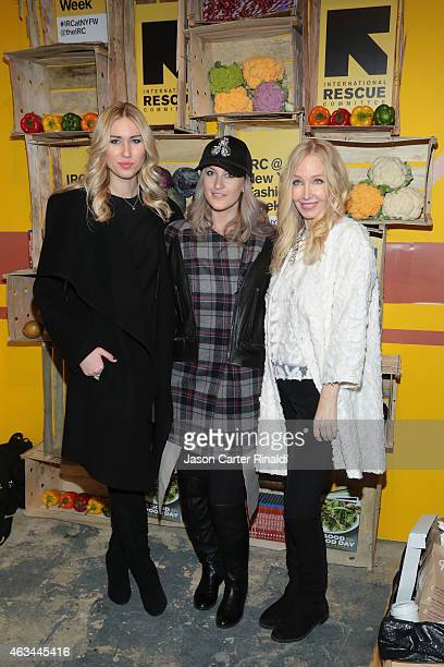 Julia Dudko Rachael Dickhute and Kristi Elong attend IRC Fashion Week PopUp and Photo Exhibition at Empire Hotel on February 14 2015 in New York City