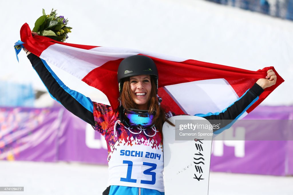 <a gi-track='captionPersonalityLinkClicked' href=/galleries/search?phrase=Julia+Dujmovits&family=editorial&specificpeople=4698927 ng-click='$event.stopPropagation()'>Julia Dujmovits</a> of Austria celebrates winning the gold medal during the flower ceremony in the Snowboard Ladies' Parallel Slalom Big Final on day 15 of the 2014 Winter Olympics at Rosa Khutor Extreme Park on February 22, 2014 in Sochi, Russia.