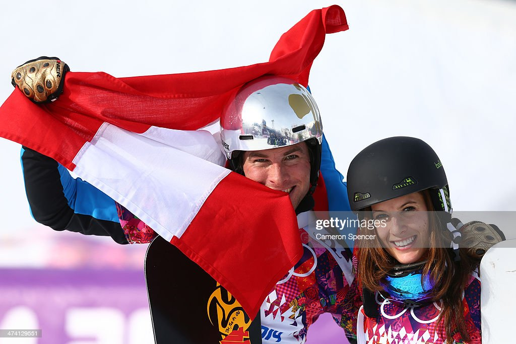 <a gi-track='captionPersonalityLinkClicked' href=/galleries/search?phrase=Julia+Dujmovits&family=editorial&specificpeople=4698927 ng-click='$event.stopPropagation()'>Julia Dujmovits</a> of Austria celebrates winning the gold medal with men's bronze medalist <a gi-track='captionPersonalityLinkClicked' href=/galleries/search?phrase=Benjamin+Karl&family=editorial&specificpeople=4586461 ng-click='$event.stopPropagation()'>Benjamin Karl</a> of Austria during the flower ceremony in the Snowboard Parallel Slalom on day 15 of the 2014 Winter Olympics at Rosa Khutor Extreme Park on February 22, 2014 in Sochi, Russia.