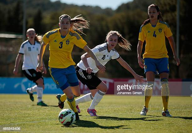 Julia Ekholm of Sweden and Laura Freigang of Germany fight for the ball during the women's U19 international friendly match between Sweden and...