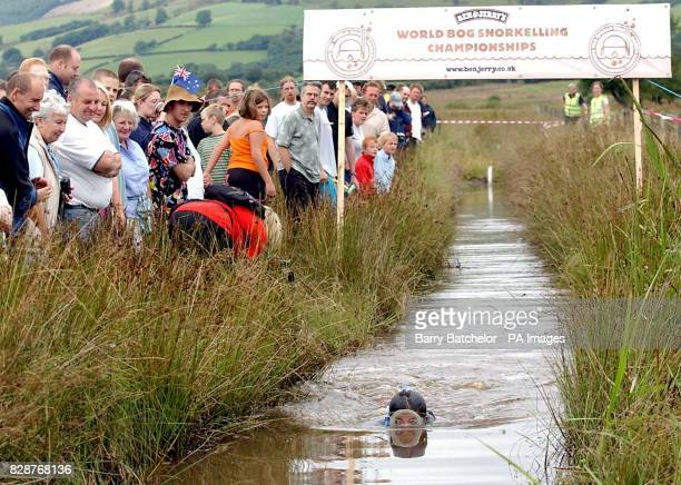 Julia Galvin from Listowel County Kerry Ireland competing in the Ben Jerry's World Bog Snorkelling Championships 2003 at the UK's smallest town...