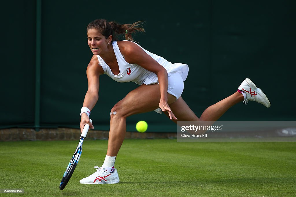 Julia Georges of Germany plays a forehand shot during the Ladies Singles first round match against Yaroslava Shvedova of kazakhstan on day one of the Wimbledon Lawn Tennis Championships at the All England Lawn Tennis and Croquet Club on June 27th, 2016 in London, England.