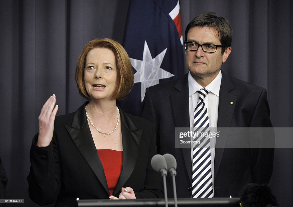 <a gi-track='captionPersonalityLinkClicked' href=/galleries/search?phrase=Julia+Gillard&family=editorial&specificpeople=787281 ng-click='$event.stopPropagation()'>Julia Gillard</a>, Australia's prime minister, left, gestures as Greg Combet, minister of climate change, looks on during a news conference at Parliament House in Canberra, Australia, on Tuesday, Nov. 8, 2011. Australia's upper house of parliament passed legislation today to make polluters pay for their carbon emissions from next year as Gillard battles to win public support for the new tax. Photographer: Mark Graham/Bloomberg via Getty Images