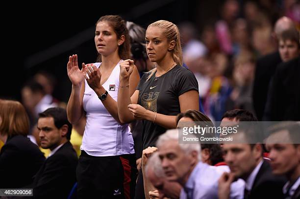 Julia Goerges and Sabine Lisicki of Germany cheer during the Fed Cup 2015 First Round tennis between Germany and Australia at PorscheArena on...