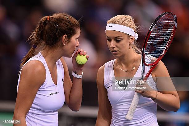 Julia Goerges and Sabine Lisicki of Germany exchange words during the Fed Cup 2015 World Group First Round tennis between Germany and Australia at...