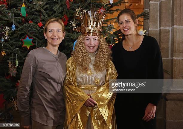 Julia Goerges German ATP tennis player and Sandra Reichel tennis tournament director of Nuernberger Versicherungscup pose with actress Barbara Otto...