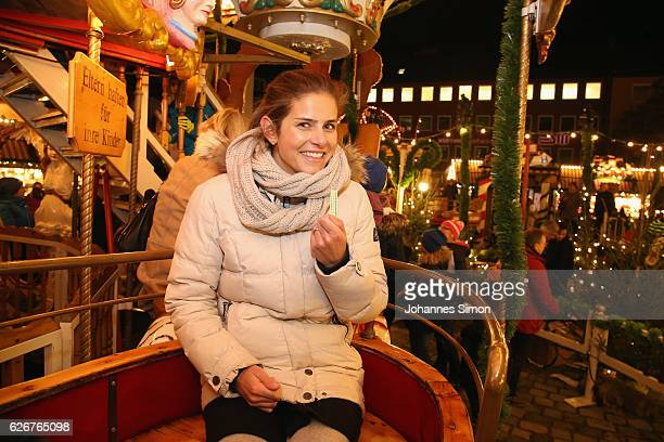 Julia Goerges German ATP tennis player promoting the Nuernberger Versicherungscup enjoys riding a merrygoround at Nuremberg Christmas market on...