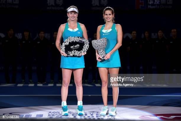 Julia Goerges of Germany and CoCo Vandeweghe of United States pose for a photo with their trophies after the women's singles final match of the 2017...
