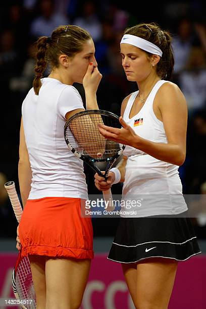 Julia Goerges of Germany and teammate Andrea Petkovic talk during their double match against Jarmila Gajdosova and Casey Dellacqua of Australia...