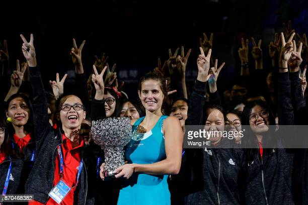 Julia Goerges of Germany celebrate with the trophy following their victory during the Ladies singles final against Coco Vandeweghe of USA on 6 day...