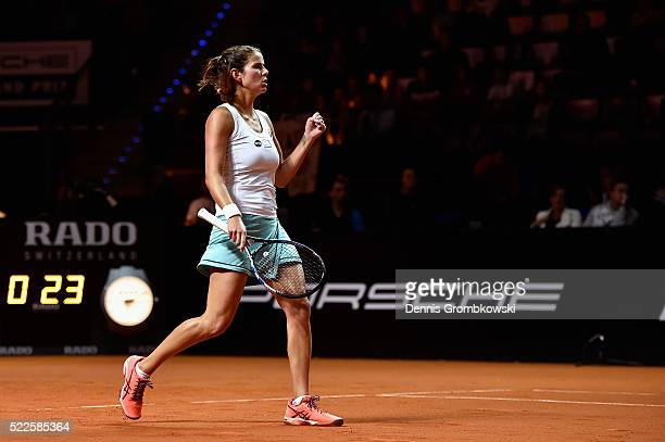 Julia Goerges of Germany celebrates a point in her match against Alize Cornet of France during Day 3 of the Porsche Tennis Grand Prix at PorscheArena...