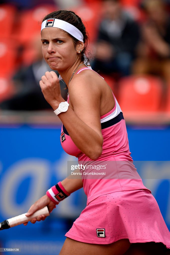<a gi-track='captionPersonalityLinkClicked' href=/galleries/search?phrase=Julia+Goerges&family=editorial&specificpeople=4474037 ng-click='$event.stopPropagation()'>Julia Goerges</a> of Germany celebrates after her first round match against Alexandra Cadantu of Romania during day four of the Nuernberger Insurance Cup on June 11, 2013 in Nuremberg, Germany.