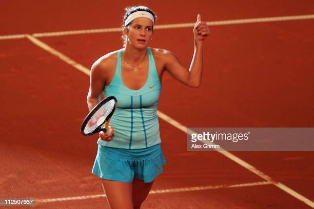 Julia Goerges of Germany celebrates after winning her first round match against Michaella Krajicek of Netherlands at the Porsche Tennis Grand Prix at...