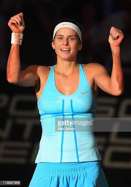 Julia Goerges of Germany celebrates after winning her Semi Final match against Samantha Stosur of Australia at the Porsche Tennis Grand Prix at...