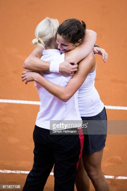 Julia Goerges of Germany celebrates victory against Lesia Tsurenko of Ukraine with head coach Barbara Rittner during the FedCup World Group PlayOff...