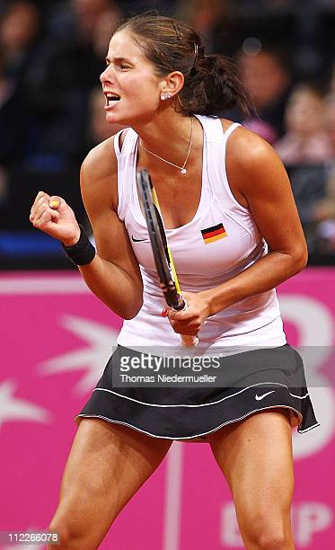 Julia Goerges of Germany gestures during her match against Melanie Oudin of USA during the first day of the Fed Cup match between Germany and United...