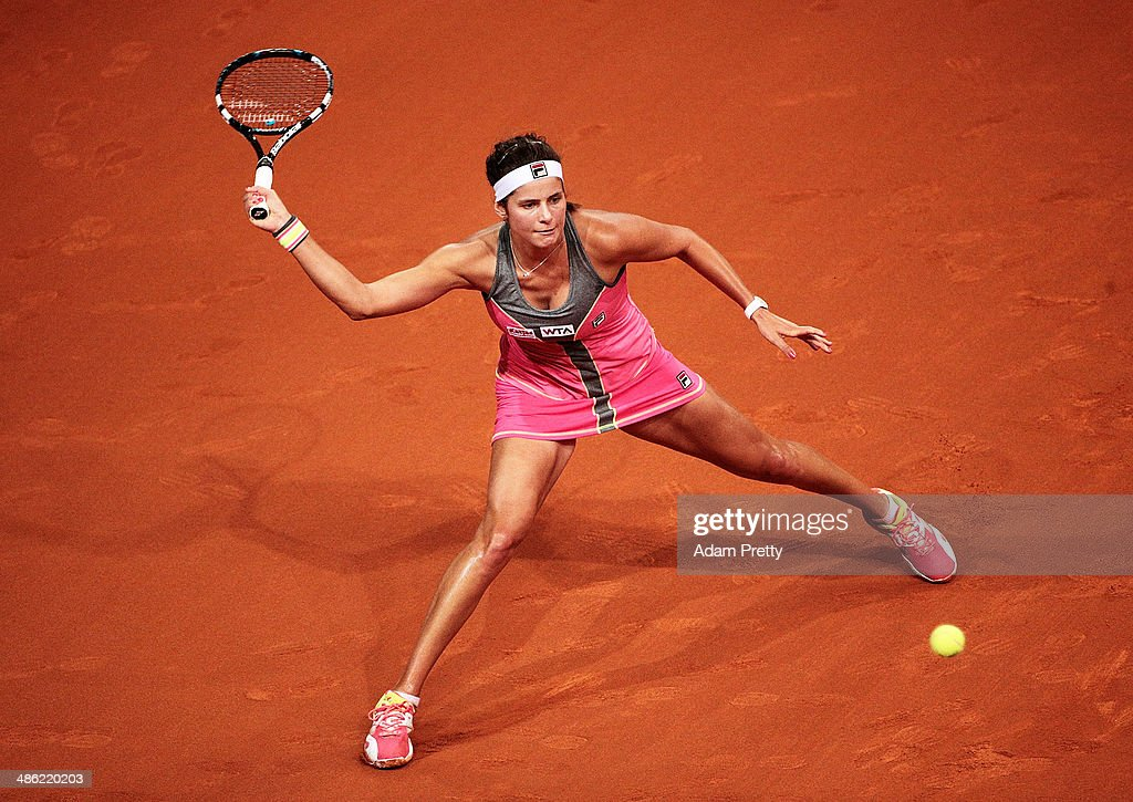 <a gi-track='captionPersonalityLinkClicked' href=/galleries/search?phrase=Julia+Goerges&family=editorial&specificpeople=4474037 ng-click='$event.stopPropagation()'>Julia Goerges</a> of Germany hits a forehand during her match against Sorana Cirstea of Romania during day 3 of the Porsche Tennis Grand Prix 2014 at Porsche-Arena on April 23, 2014 in Stuttgart, Germany.