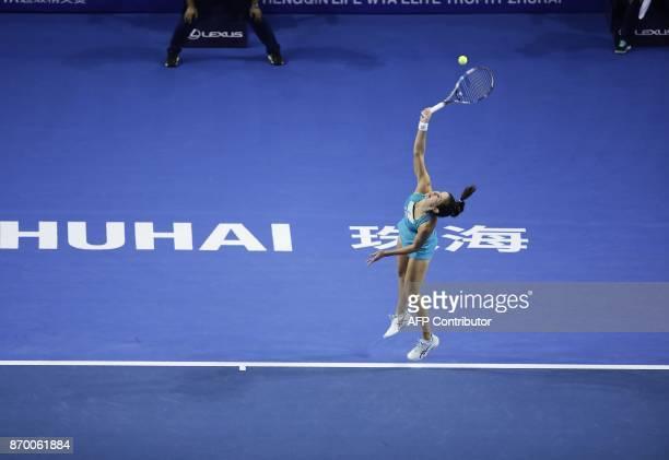 Julia Goerges of Germany hits a return against Anastasija Sevastova of Latvia during their women's singles semifinal match at the Zhuhai Elite Trophy...