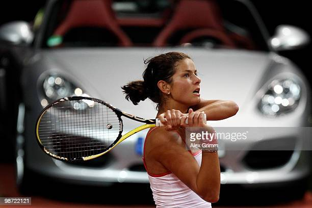 Julia Goerges of Germany plays a backhand during her first round match against Justine Henin of Belgium at day three of the WTA Porsche Tennis Grand...