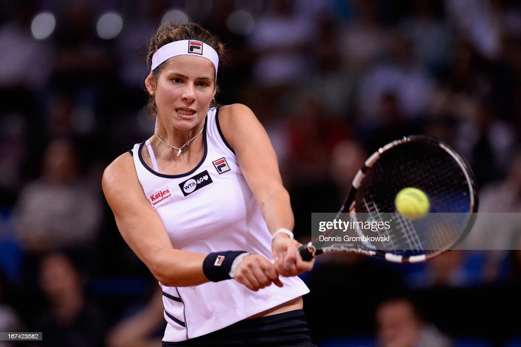 Julia Goerges of Germany plays a backhand in her match against Petra Kvitova of Czech Republic during Day 4 of the Porsche Tennis Grand Prix at Porsche-Arena on April 25, 2013 in Stuttgart, Germany.