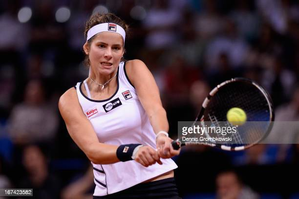 Julia Goerges of Germany plays a backhand in her match against Petra Kvitova of Czech Republic during Day 4 of the Porsche Tennis Grand Prix at...