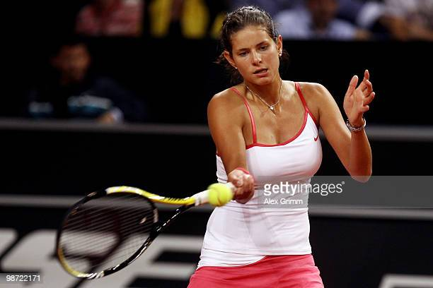 Julia Goerges of Germany plays a forehand during her first round match against Justine Henin of Belgium at day three of the WTA Porsche Tennis Grand...