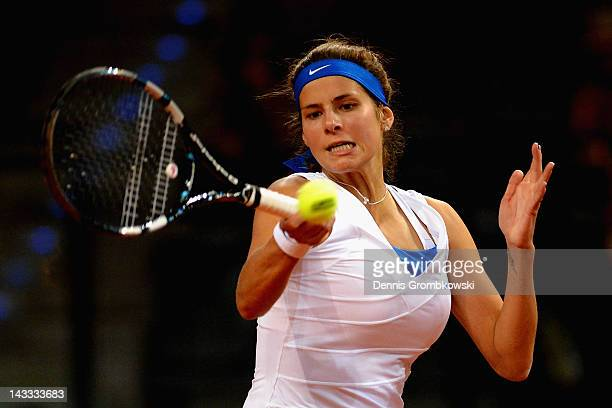 Julia Goerges of Germany plays a forehand in her match against Anastasia Pavlyuchenkova of Russia during day two of the WTA Porsche Tennis Grand Prix...