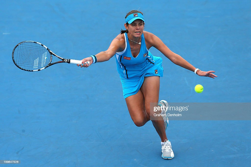 Julia Goerges of Germany plays a forehand in her third round match against Jie Zheng of China during day five of the 2013 Australian Open at Melbourne Park on January 18, 2013 in Melbourne, Australia.
