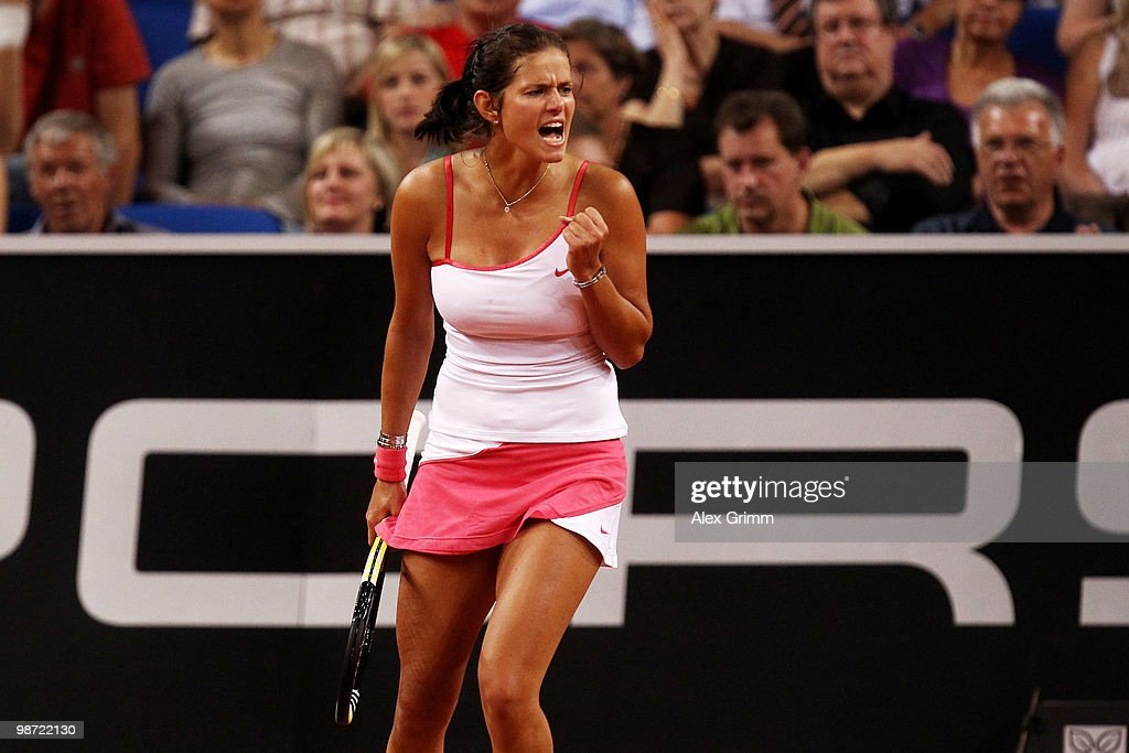 <a gi-track='captionPersonalityLinkClicked' href=/galleries/search?phrase=Julia+Goerges&family=editorial&specificpeople=4474037 ng-click='$event.stopPropagation()'>Julia Goerges</a> of Germany reacts during her first round match against Justine Henin of Belgium at day three of the WTA Porsche Tennis Grand Prix Tournament at the Porsche Arena on April 28, 2010 in Stuttgart, Germany.