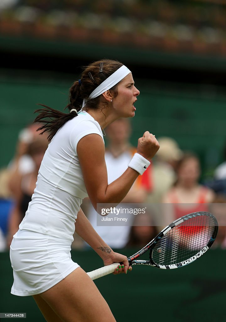 <a gi-track='captionPersonalityLinkClicked' href=/galleries/search?phrase=Julia+Goerges&family=editorial&specificpeople=4474037 ng-click='$event.stopPropagation()'>Julia Goerges</a> of Germany reacts during her Ladies' Singles second round match against Anastasiya Yakimova of Belarus on day four of the Wimbledon Lawn Tennis Championships at the All England Lawn Tennis and Croquet Club on June 28, 2012 in London, England.