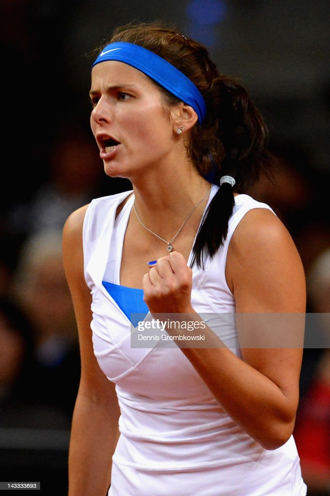 <a gi-track='captionPersonalityLinkClicked' href=/galleries/search?phrase=Julia+Goerges&family=editorial&specificpeople=4474037 ng-click='$event.stopPropagation()'>Julia Goerges</a> of Germany reacts during her match against Anastasia Pavlyuchenkova of Russia during day two of the WTA Porsche Tennis Grand Prix at Porsche Arena on April 24, 2012 in Stuttgart, Germany.