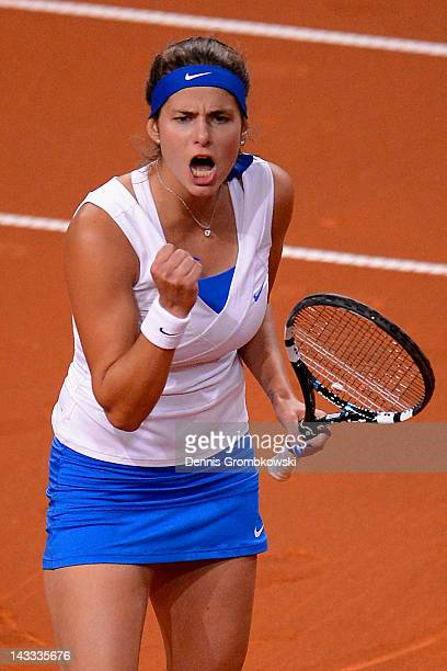 Julia Goerges of Germany reacts during her match against Anastasia Pavlyuchenkova of Russia during day two of the WTA Porsche Tennis Grand Prix at...