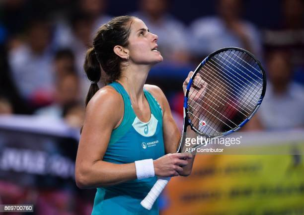 Julia Goerges of Germany reacts during her women's singles match against Kristina Mladenovic of France at the Zhuhai Elite Trophy tennis tournament...