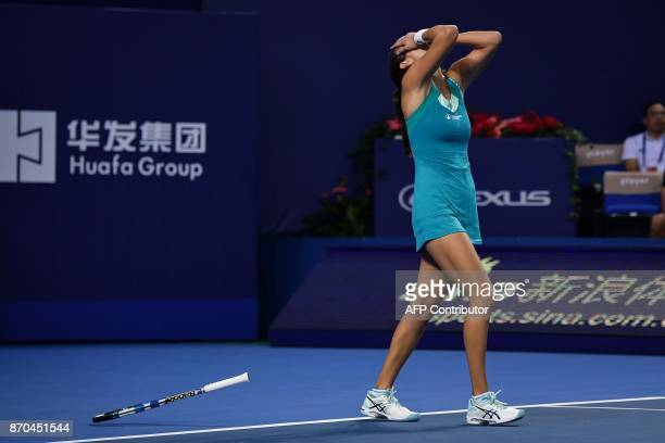 Julia Goerges of Germany reacts during the women's singles final against Coco Vandeweghe of the US at the Zhuhai Elite Trophy tennis tournament in...