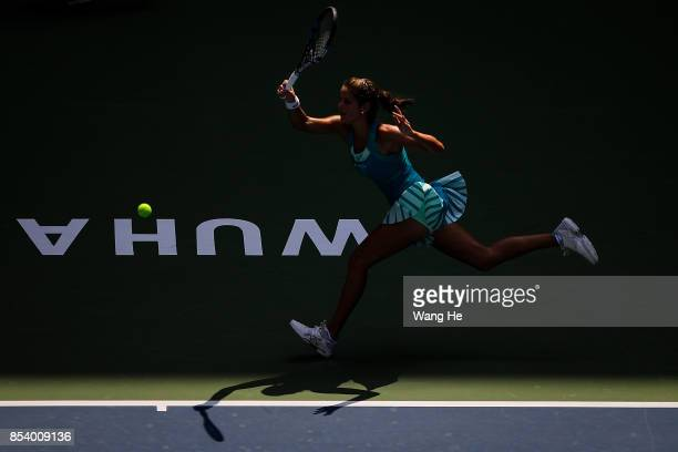 Julia Goerges of Germany returns a shot during the match against Agnieszka Redwanska of Poland on Day 3 of 2017 Dongfeng Motor Wuhan Open at Optics...