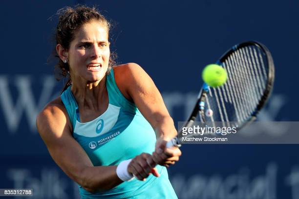 Julia Goerges of Germany returns a shot to Sloane Stephens during day 7 of the Western Southern Open at the Lindner Family Tennis Center on August 18...