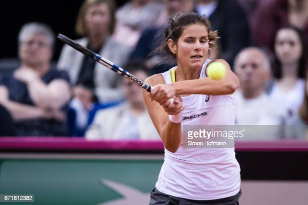 Julia Goerges of Germany returns the ball against Lesia Tsurenko of Ukraine during the FedCup World Group PlayOff match between Germany and Ukraine...