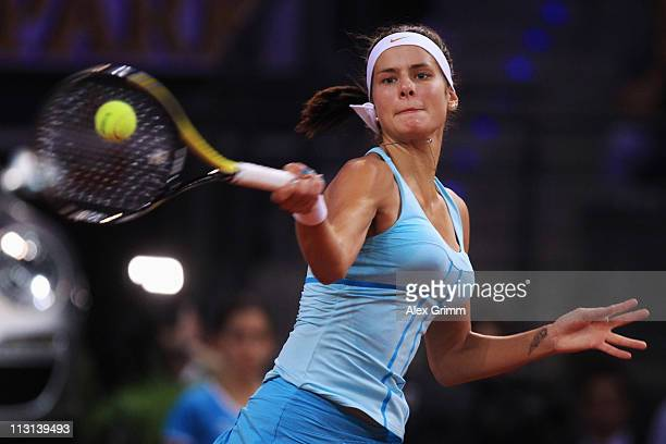 Julia Goerges of Germany returns the ball to Caroline Wozniacki of Denmark during the Final match at the Porsche Tennis Grand Prix at Porsche Arena...
