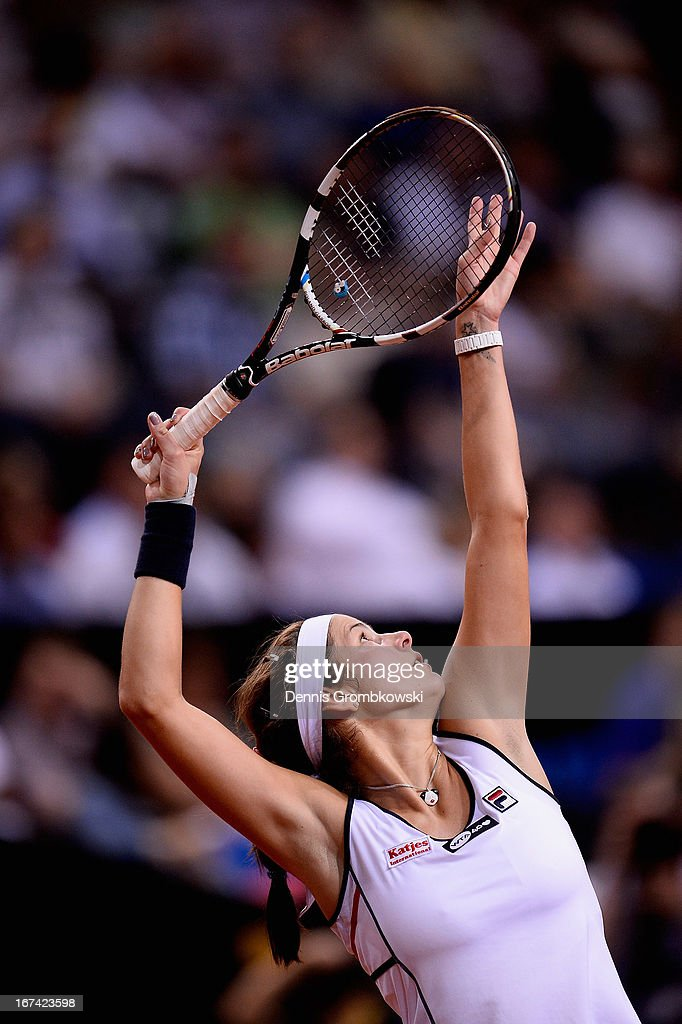 <a gi-track='captionPersonalityLinkClicked' href=/galleries/search?phrase=Julia+Goerges&family=editorial&specificpeople=4474037 ng-click='$event.stopPropagation()'>Julia Goerges</a> of Germany serves in her match against Petra Kvitova of Czech Republic during Day 4 of the Porsche Tennis Grand Prix at Porsche-Arena on April 25, 2013 in Stuttgart, Germany.