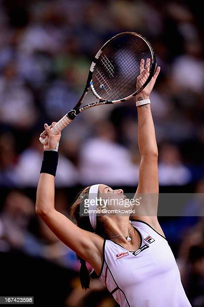 Julia Goerges of Germany serves in her match against Petra Kvitova of Czech Republic during Day 4 of the Porsche Tennis Grand Prix at PorscheArena on...