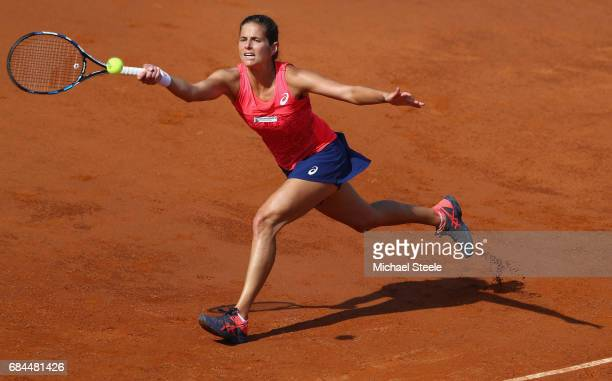 Julia Goerges of Germany stretches for a return during the women's third round match against Garbiñe Muguruza of Spain on Day Five of the...