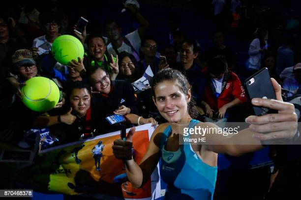 Julia Goerges of Germany uses iphone takes pictures after wins the final match against Coco Vandeweghe of USA during the WTA Elite Trophy Zhuhai 2017...