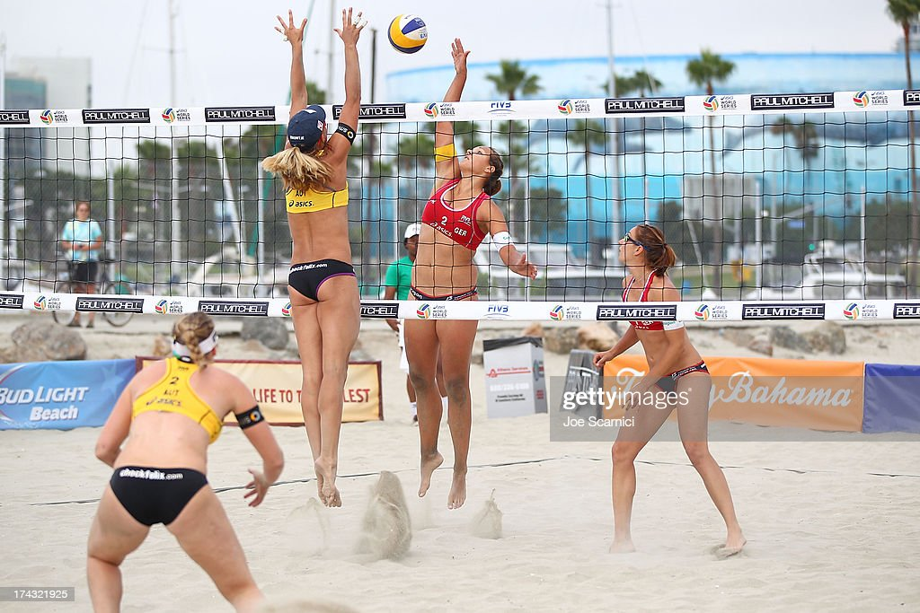 Julia Grossner of Germany (center R) blocks a spike by Barbara Hansel of Austria at the ASICS World Series of Beach Volleyball - Day 2 on July 23, 2013 in Long Beach, California.