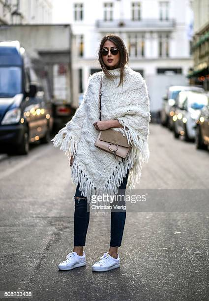Julia Haghjoo wearing Adidas shoes Levis jeans Chloe bag Cashmere poncho outside Jesper Hovring Great Greenland during the Copenhagen Fashion Week...