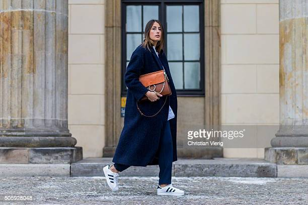 Julia Haghjoo wearing MIH Jeans coat shoes Adidas bag Choe outside Dorothee Schumacher during the MercedesBenz Fashion Week Berlin Autumn/Winter 2016...