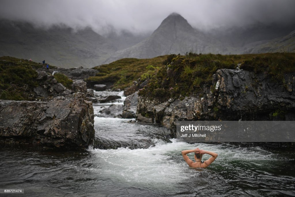 Julia Johansson from Finland swims in the Fairy Pools on the Isle of Skye on August 18, 2017 in Glenbrittle, Scotland. The Isle of Skye is known as one of the most beautiful places in Scotland, however its infrastructure services are being stretched to the limit by the number of visitors heading there to enjoy its rugged scenic beauty.